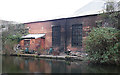 SK3788 : Canalside Dereliction by Anne Burgess