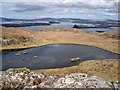 NG3132 : View north over a lochan by Richard Dorrell