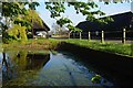 TL9222 : A Copford Pond & Cart Lodge by Glyn Baker