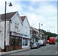 ST1490 : A takeaway and a pharmacy, Llanbradach High Street by John Grayson