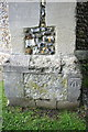 TQ4396 : Benchmark on buttress of St Nicholas Loughton church by Roger Templeman
