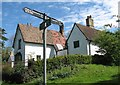 TL3456 : Caldecote: signpost by John Sutton