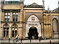 TQ3104 : Cyclist passing Brighton Dome by Paul Gillett