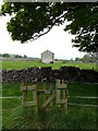 SK2068 : Gate, stile and barn by Graham Hogg