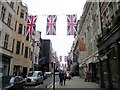 TQ2980 : Union Jacks in Old Bond Street London by PAUL FARMER
