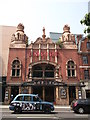 On Mare Street.  The building is Grade II* listed. Built in 1901.  See http://www.britishlistedbuildings.co.uk/en-424483-the-hackney-empire-291-hackney for more details.