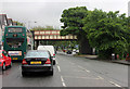SJ8590 : Wilmslow Road (A5145) and railway bridge by Peter Turner