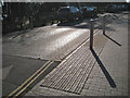 SP2054 : Speed table and tactile paving, Southern Lane by Robin Stott