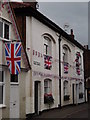 TQ0747 : Flag-bedecked Shere by Colin Smith