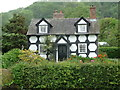 SO1797 : Black and white cottage near Fron, Powys by Jeremy Bolwell