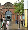 SJ9399 : An entrance to Ashton Market Hall by Gerald England