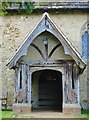 SU9936 : Dunsfold church: the south porch by Stefan Czapski
