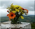 NT5815 : Flowers on Rubers Law trig point by Walter Baxter