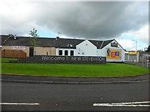 NS7659 : Centre of New Stevenston by Stephen Sweeney