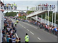 SZ0894 : Ensbury Park: people line Boundary Lane ahead of the Olympic torch by Chris Downer