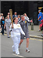 TQ8209 : Torch bearer, Day 61 Olympic Torch Relay by Oast House Archive