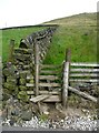 SD9624 : Stile at the foot of a useful path down the edge of an access land field  by Humphrey Bolton