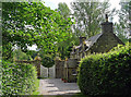 NH5154 : Brahan Estate cottage at the entrance to the walled garden by Dr Julian Paren
