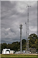 TQ1851 : Temporary masts by Ian Capper