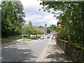 SD9905 : Uppermill High Street by John Slater