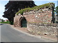 NO2418 : Walls and Norman-arched entrance to Lindores Abbey by jim and liz denham