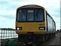 SX9780 : Cockwood - train approaching by Chris Allen