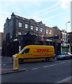 TQ3078 : DHL Van passing Eagle London in Kennington Lane by PAUL FARMER