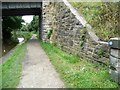 SK3873 : Drone Valley Way waymarker on bridge abutment by Christine Johnstone