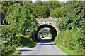 SH8902 : Road approaching railway bridge in Llanbrynmair by Nigel Brown