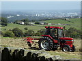 SK2883 : Tractor in a field overlooking Sheffield by Andrew Hill