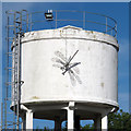TQ5980 : Sculpture on water tower by Roger Jones
