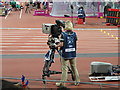 TQ3784 : Olympic Broadcasting Services TV camera in Olympics Stadium by David Hawgood