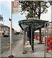 SJ9494 : Bus Shelter being painted by Gerald England
