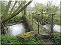SP2186 : Footbridge across the Blythe in the rain by Robin Stott