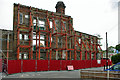 TQ5669 : Preserving the mill facade by Robin Webster