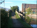 SJ9397 : Ashton Canal footbridge 27A by John Slater