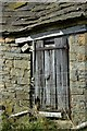 SK2370 : Door to derelict farm building west of Pilsley by Neil Theasby
