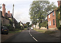 SP7920 : Oving road through Whitchurch by John Firth