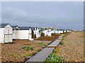 TQ2004 : Beach huts, Lancing Beach by Robin Webster