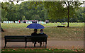 TQ2880 : Umbrella couple, Green Park by Julian Osley