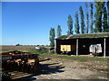 TL2778 : Barn and farm machinery near Broughton by Marathon