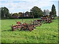 SK9159 : Farm machinery by Carlton Road, Bassingham by Oliver Dixon