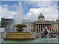 TQ2980 : Fountain and Olympic countdown clock in Trafalgar Square by Graham Robson