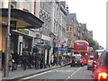 TQ2579 : High Street Kensington by the station by David Howard