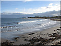 NU2424 : View across the bay to Dunstanburgh Castle by Pauline Eccles