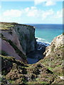 SW6746 : Steep cliffs and cove north of Nancecuke Airfield by Richard Law