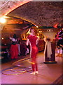 TQ3380 : Acrobat at Medieval Banquet, London, E1 by Christine Matthews