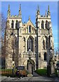 SE6132 : Selby Abbey with solitary woman on bench by Neil Theasby