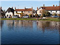 SP7408 : Cottages beyond Haddenham duck pond by Michael Trolove