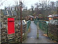 SK3180 : Railway footbridge and post box by Andrew Hill